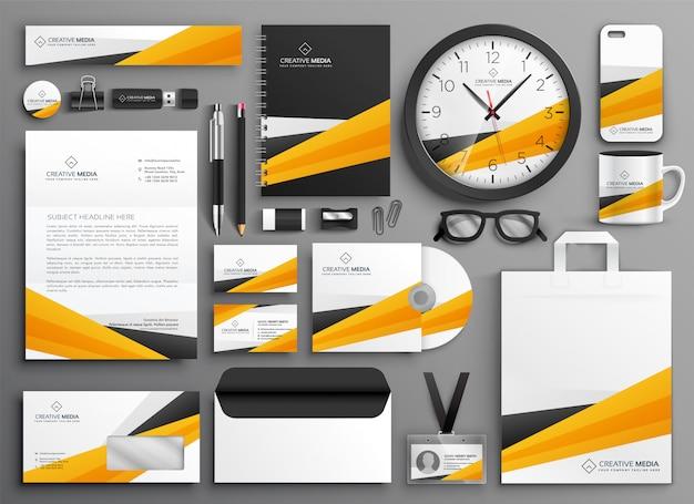 Conjunto de papelería de negocios amarillos abstractos vector gratuito