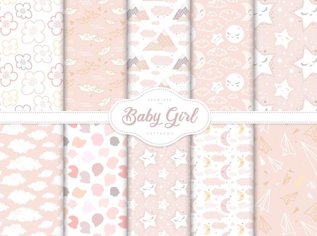 Conjunto de patrones sin fisuras de color rosa para la pequeña guardería de niña bebé Vector Premium