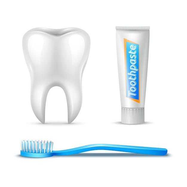 Conjunto realista de cepillo de dientes y pasta de dientes humanos vector gratuito