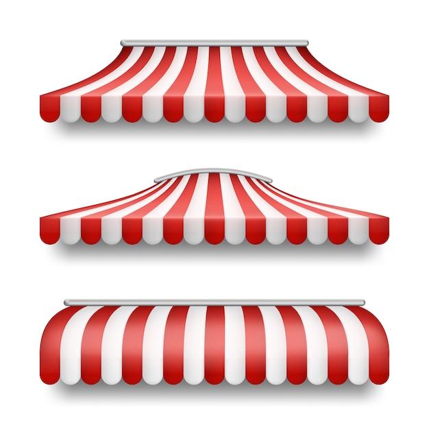 Conjunto realista de toldos a rayas aislados sobre fondo. vector gratuito