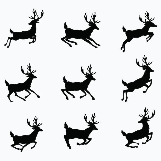 Conjunto de siluetas de ciervos corriendo. colección de ciervos de navidad. ilustración. Vector Premium