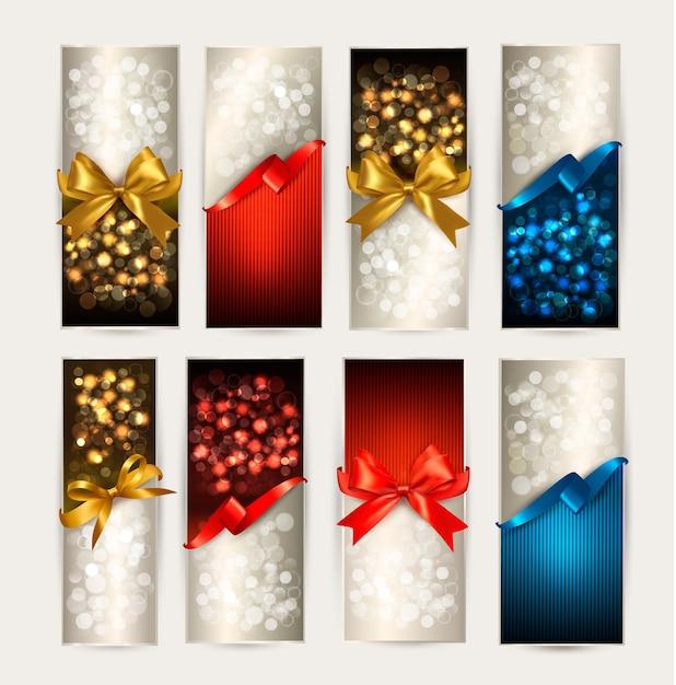 Conjunto de tarjetas de regalo coloridas con moños de regalo con cintas Vector Premium