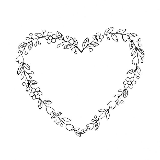 Corona dibujada a mano en forma de corazón con flores. fronteras de dibujo floral, marco de corazón. Vector Premium