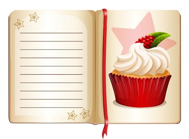 Cuaderno con cupcake en la página vector gratuito