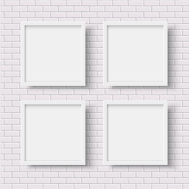 Cuatro marcos vacíos cuadrados blancos en pared de ladrillo blanco Vector Premium