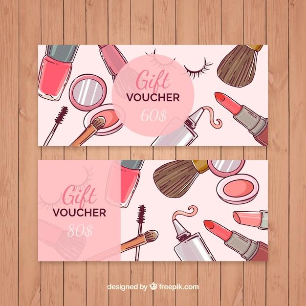 Cupones de regalo de maquillaje dibujados a mano Vector Premium