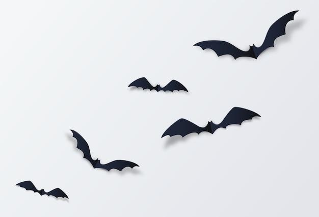 Decoración de murciélagos de halloween. estilo de corte de papel. vector gratuito