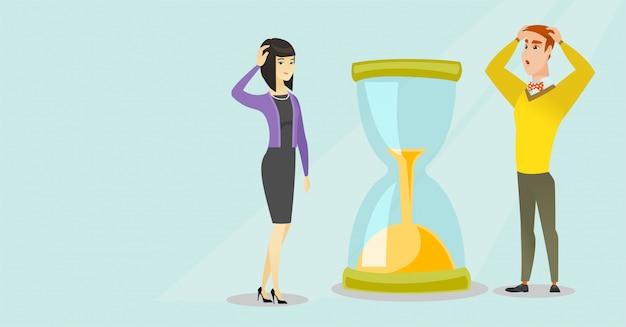 Desesperados empresarios mirando el reloj de arena. Vector Premium