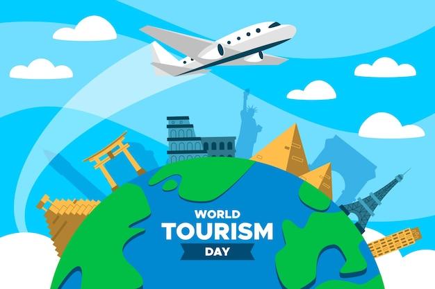 Día mundial del turismo en plano con avión. vector gratuito