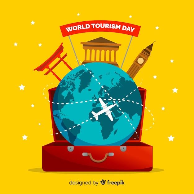 Día mundial del turismo plano en un equipaje vector gratuito