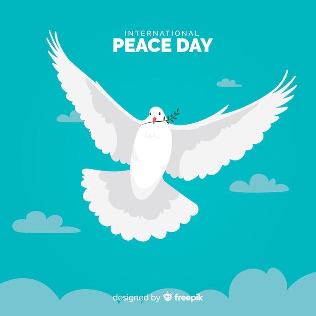 Día de la paz plana con paloma vector gratuito