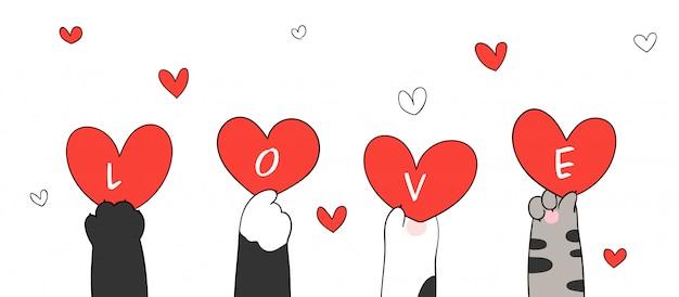 Dibuja patas de gato con corazón rojo y palabra amor para la tarjeta de felicitación de san valentín Vector Premium