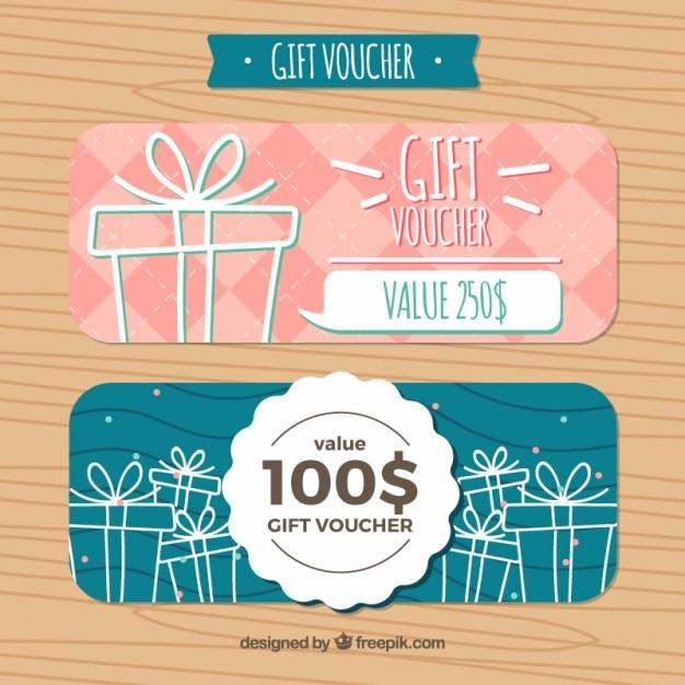 Dibujados a mano los regalos de cupones de descuento vector gratuito