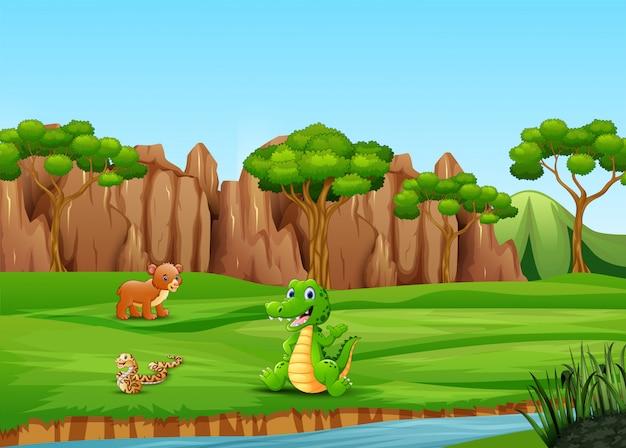 Dibujos animados de animales felices en el campo Vector Premium