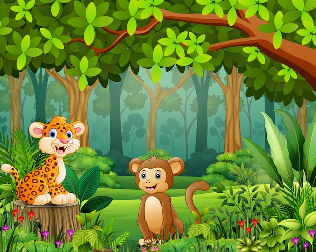 Dibujos animados de animales en el hermoso paisaje de bosque verde Vector Premium