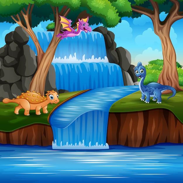 Dibujos animados dinosaurios felices en la naturaleza Vector Premium