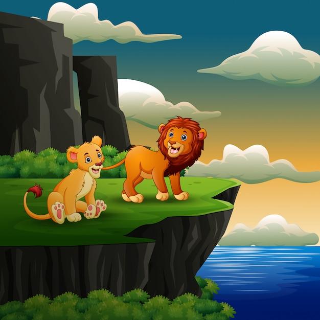 Dibujos animados de leones rugiendo en el fondo del acantilado Vector Premium