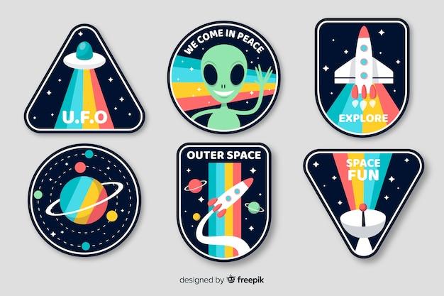 Diseño artístico de la colección de adhesivos espaciales vector gratuito