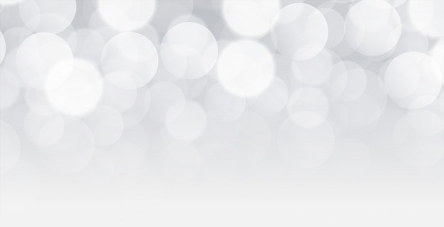 Diseño de fondo blanco bokeh con espacio de texto vector gratuito
