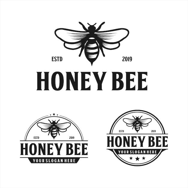 Diseño de logo vintage de abeja Vector Premium