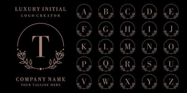 Diseño de logotipo de insignia inicial de lujo con marco floral Vector Premium
