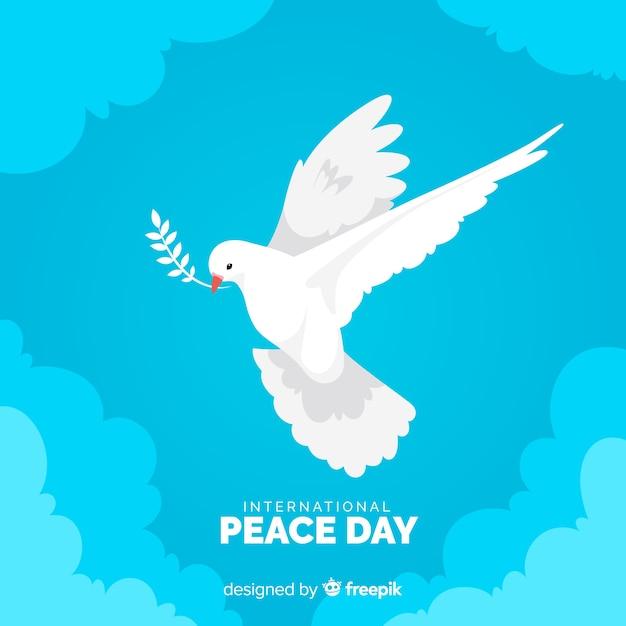 Diseño plano día de la paz con paloma vector gratuito