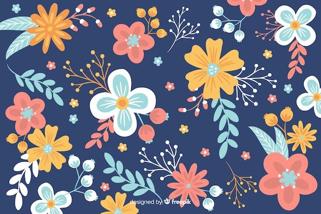 Diseño plano de fondo floral hermoso vector gratuito