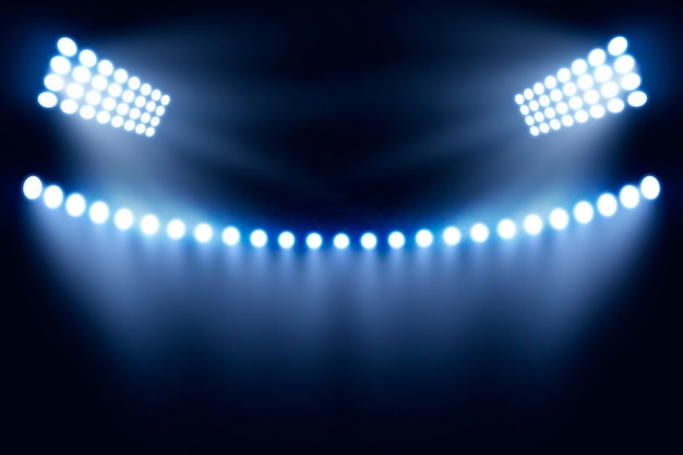 Diseño realista de luces brillantes del estadio vector gratuito
