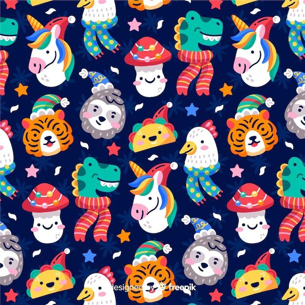 Divertido patrón de navidad con animales y tacos vector gratuito