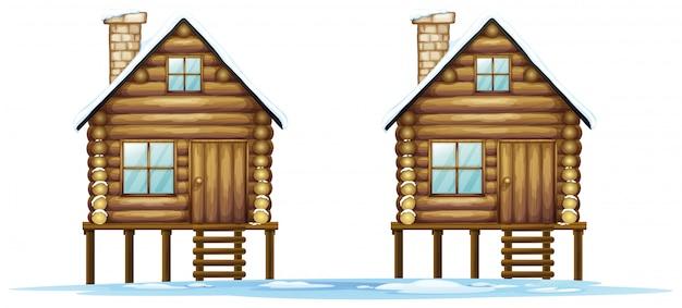 Dos cabañas de madera en el campo. vector gratuito