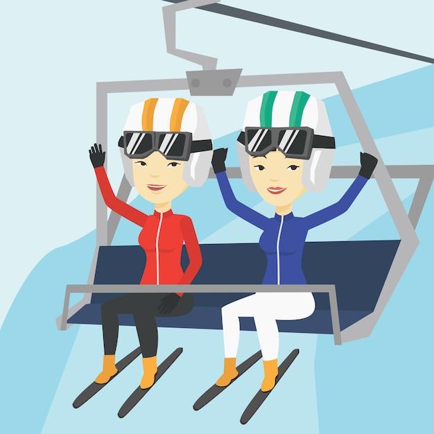 Dos esquiadores felices usando el teleférico en la estación de esquí. Vector Premium