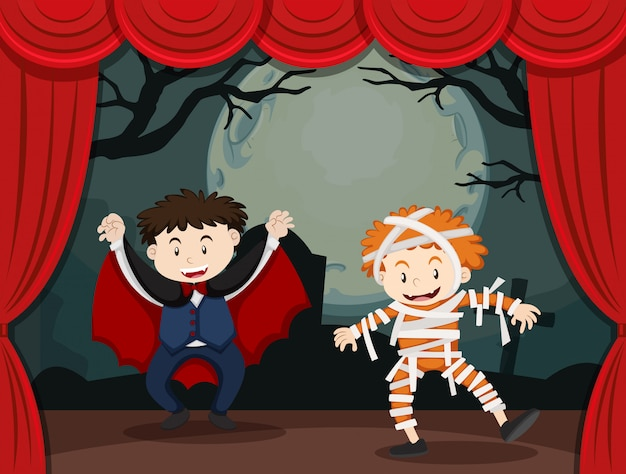 Dos niños disfrazados de halloween en el escenario vector gratuito