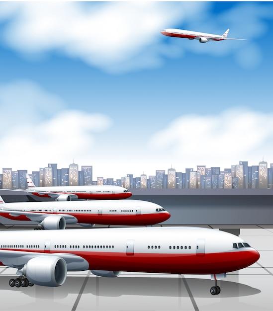 Edificio del aeropuerto con estacionamiento de aviones. Vector Premium