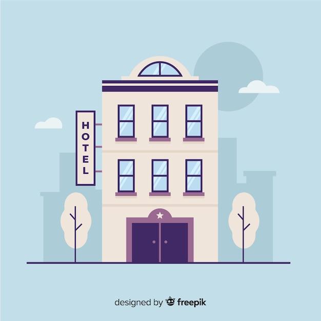 Edificio hotelero en la ciudad vector gratuito