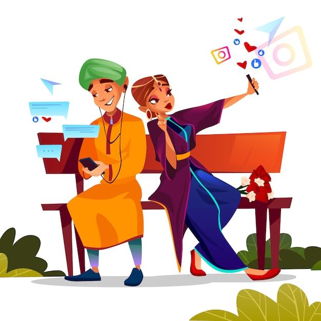 Ejemplo joven de la datación de los pares del muchacho y de la muchacha indios adolescentes en la sari que se sienta en banco junto vector gratuito