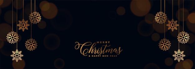 Elegante banner de navidad negro con copos de nieve dorados vector gratuito