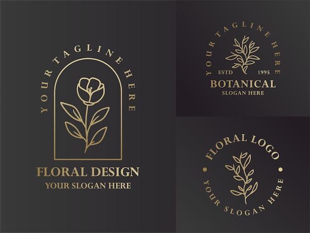 Elegante diseño de logotipo floral y botánico monoline negro y dorado Vector Premium