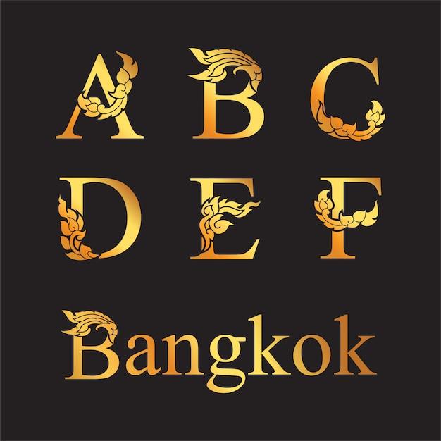 Elegante letra dorada a, b, c, d, e, f con elementos de arte tailandés. Vector Premium