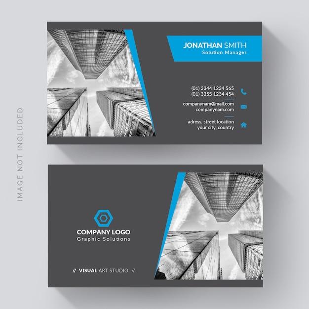 Elegante tarjeta de visita corporativa con foto de la ciudad. vector gratuito
