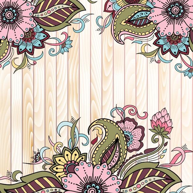 Elementos florales abstractos en estilo mehndi indio sobre fondo de madera. vector gratuito