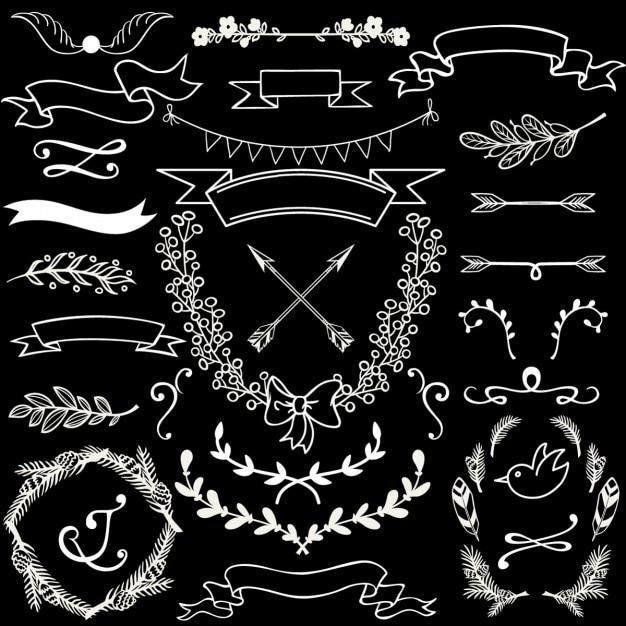Elementos ornamentales dibujados a mano sobre un fondo negro vector gratuito