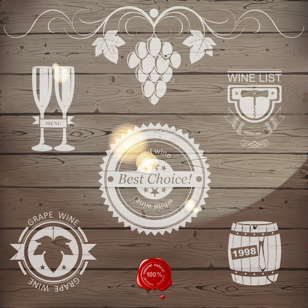 Emblemas de vino o logo en madera Vector Premium
