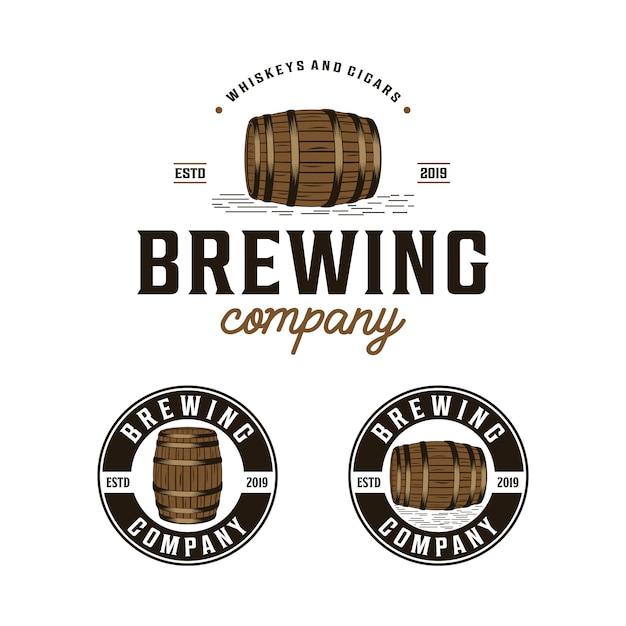 Empresa cervecera con logotipo barril vintage. Vector Premium