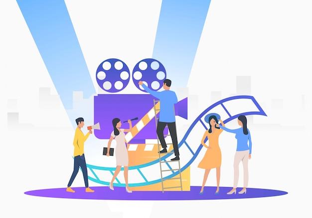 Equipo de camarógrafos preparándose para la película vector gratuito