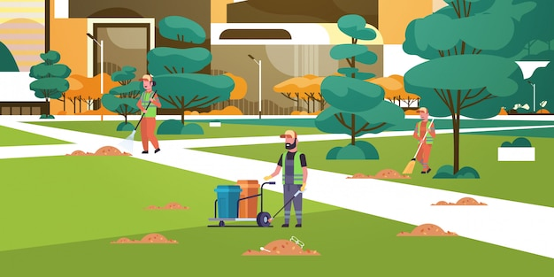 Equipo de conserjes recolectando basura a limpiadores de basura usando el servicio de limpieza de estantes y escobas Vector Premium