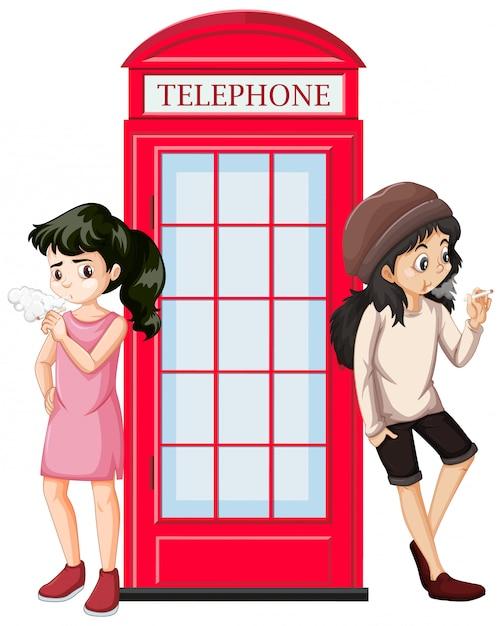 Escena con dos adolescentes fumando junto a la cabina telefónica vector gratuito
