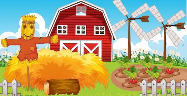 Escena de la granja en la naturaleza con granero y molino de viento y espantapájaros vector gratuito
