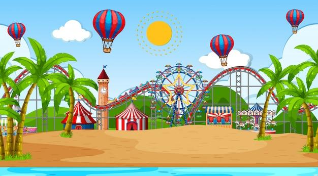 Escena con muchos juegos de circo y globos aerostáticos en la playa. Vector Premium