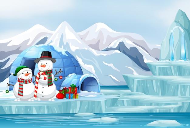 Escena con muñeco de nieve e iglú vector gratuito