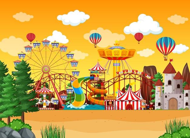 Escena del parque de atracciones durante el día con globos en el cielo. vector gratuito